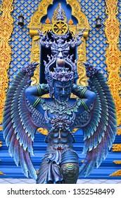 Sculpture in Blue Temple or Wat Rong Suea Ten of Chiang Rai