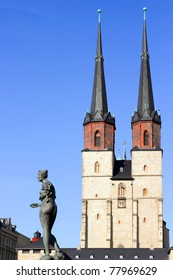 Sculpture and blue towers in Halle (Saale), Germany