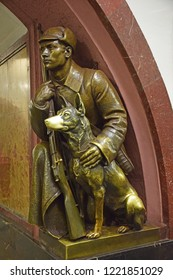 The sculpture of a border guard warrior with a dog is located at the Ploshchad Revolutsii metro station. Sculptor Matvey Manizer. Established in 1938. Moscow, Russia, September 2018.