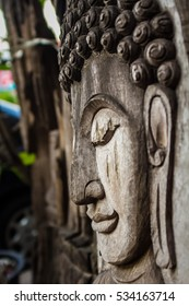 sculpture of Buddha  has a very shallow depth of field.