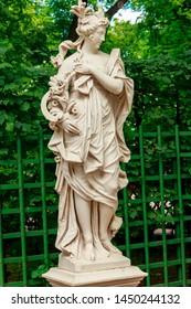 """Sculpture """"Ceres"""" in old city park """"Summer garden"""" in St. Petersburg, Russia"""