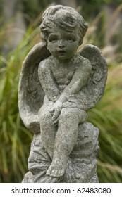 Sculpture of a cherub in Georgetown cemetery, in Washington DC.