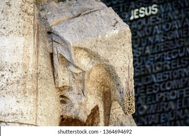 Sculpture of Christ with word Jesus on door of the Gaudi's Sagrada Familia in Barcelona, Spain.