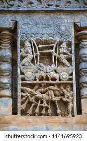 Sculpture depicting a war between Bhishma and Arjuna. Bhishma lying on the bed of arrows. Chennakeshava temple. Belur, Karnataka, India. An episode from Mahabharata.