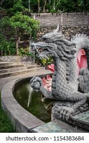 Sculpture of dragon in budhist temple Brahma Vihara-Arama Banjar in Lovina, Indonesia, Bali.