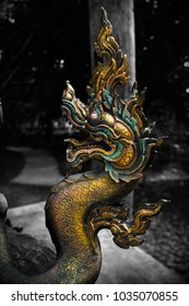 The sculpture of a dragon, which is the mythical creature at the stairway into the main building of the Buddhist temple