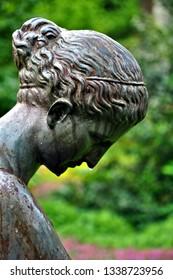 Sculpture element (women's head) in city park, Vendome. France. Vendome - popular tourist destination in Loire Valley.  Photo taken 2014-05-01.