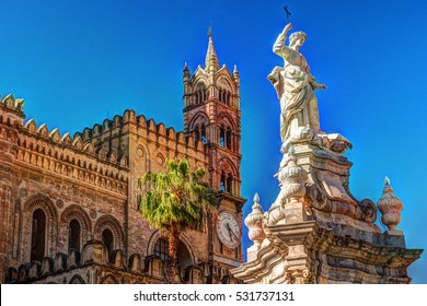 Sculpture in front of Palermo Cathedral church against blue sky, Sicily, Italy