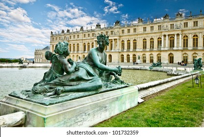 sculpture in the garden of chateau de Versailles with blue sky, France (composition)