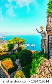 Sculpture and gardens in Capri Island town in Italy, Naples. Landscape with Blue Mediterranean Sea, Italian coast. Anacapri in Europe. View on Faraglioni in summer. Amalfi scenery and Solaro mountain