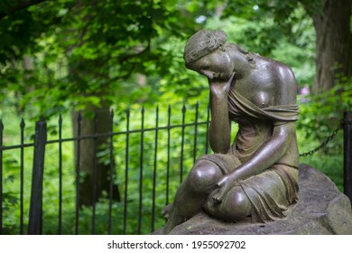 sculpture of a girl in the park stone monument woman