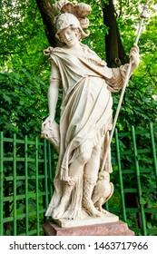 """Sculpture of goddess Minerva in old city park """"Summer garden"""" in St. Petersburg, Russia"""