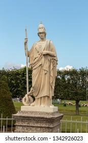 Sculpture «Greek goddess Minerva» in the old public park «Peterhof».  Copy. St. Petersburg, Russia, July 30, 2017.