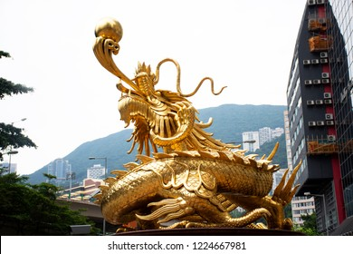 Sculpture golden dragon guardian at roundabout at Morrison Hill Road for travelers people travel visit in Hong Kong, China