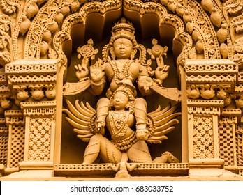 A sculpture of the Hindu God Vishnu on his carrier Garuda at the temple of Srikantheswara in Nanjangud, South India.