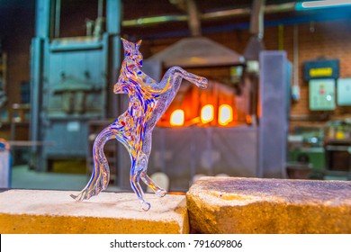 Sculpture of horse made of murano glass cooling in a factory in Murano, Italy.