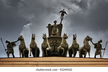 The sculpture of horses on the triumphal arch of St. Petersburg in the sky