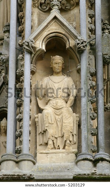 Sculpture of a king on the west font of Wells Cathedral in Somerset, England.