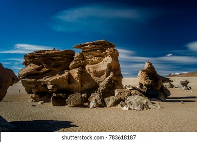 Sculpture like rock formation scenery of during dessert crossing with a 4x4  in Uyuni Salt Flats in Bolivia.