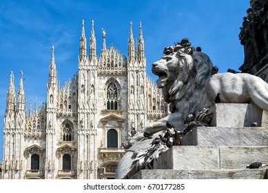Sculpture of a lion in the Piazza del Duomo (Cathedral Square) in Milan, Italy. The Milan Cathedral (Duomo di Milano) in the background. Cathedral Square is the main tourist attraction of Milan.