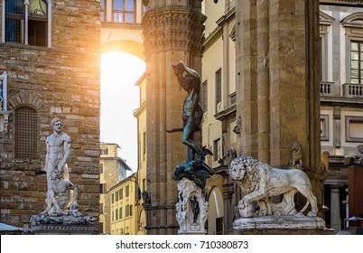 Sculpture of Loggia dei Lanzi and Florence Palazzo Vecchio on Piazza della Signoria in Florence, Italy. Architecture and landmark of Florence