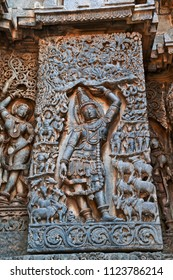 Sculpture of lord Krishna as Govardhan Girdhari, west side wall, Hoysaleshwara temple, Halebidu, Karnataka.