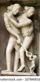 Sculpture of love making couple on the temple at Khajuraho in India, popular worldwide for its outstanding architectural designs and the art of ecstacy. It is a unesco world Heritage site