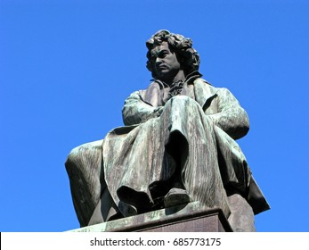 Sculpture of Ludwig van Beethoven isolated on clear blue sky. Austria, Vienna.