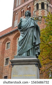 The sculpture of Nikolai Copernicus against the background of the old city hall, 1853. Torun, Poland