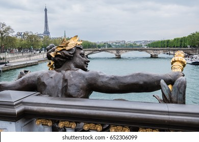 Sculpture on Alexandre III bridge. The bridge, with its exuberant Art Nouveau lamps, cherubs, nymphs and winged horses at either end, was built between 1896 and 1900.