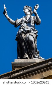 A sculpture on the exterior of the Clarendon Building in the historic city of Oxford in the UK.