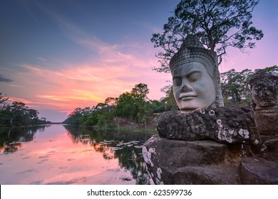 Sculpture outside south gate of Angkor Thom at sunset, Siem Reap, Cambodia