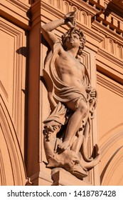 Sculpture of a partly nude male on the former stock exchange building in Riga, Latvia