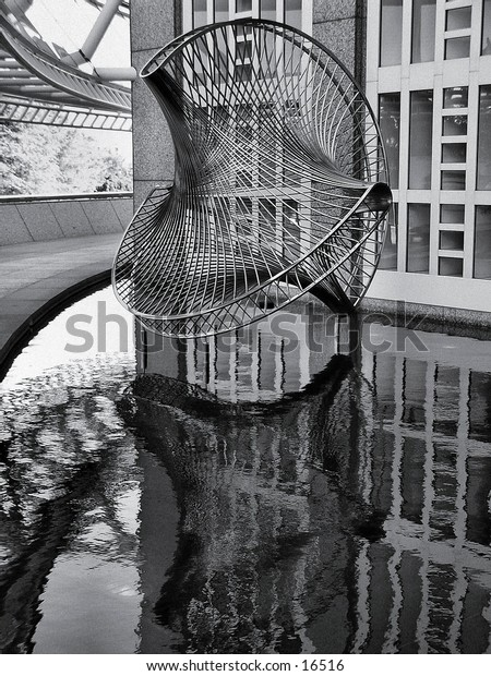 Sculpture in a reflecting pool