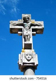 sculpture of a roman christ in a cross