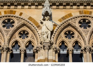 A sculpture of Saint George on the exterior of the historic Northampton Guildhall in the town of Northampton, UK.