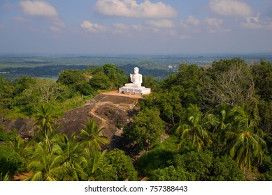A sculpture of a seated Buddha on top of the Ambasthala mountain. Mihintale, Sri Lanka