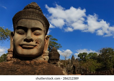 Sculpture at South Gate of Angkor Thom, founded by Jayavarman VII around late 12th century. The Face Tower as background.