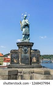 Sculpture of St. John of Nepomuk on the Charles Bridge in Prague