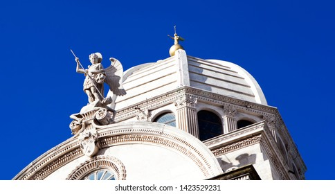 Sculpture of St. Michael, striking the devil and the angel on the top of the dome of the Cathedral of St. James. Šibenik. Croatia