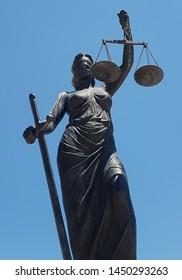 Sculpture of Themis, mythological Greek goddess, symbol of justice