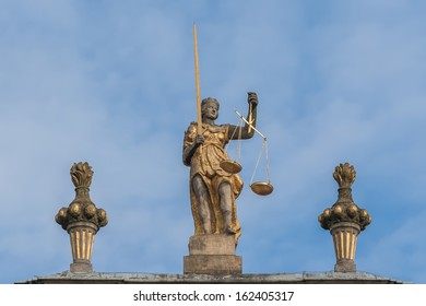 Sculpture of Themis with scales and sword.