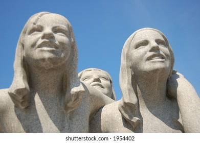 Sculpture of three girls on Monolith plateau in Vigeland park, Oslo