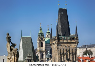 Sculpture and the Tower of Charles Bridge in Prague
