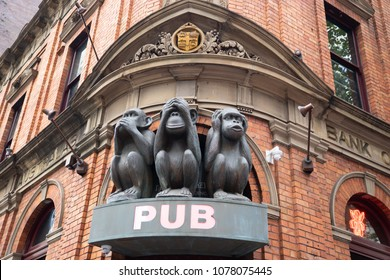 The Sculpture of Tree monkeys with different faces, No Speak, No See, No Hear on the gate of pub in Sydney, 3 monkeys pub located on George street in Sydney, Australia:15/04/18no, monkeys, evil, three