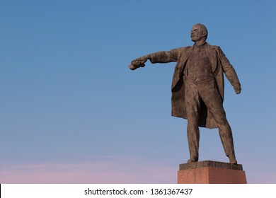 Sculpture of Vladimir Ilyich Lenin in the town square. Concept for printing leaflets, banners, cards, with place for text. SAINT-PETERSBURG, RUSSIA - 7 APRIL 2019.
