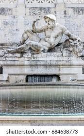 sculpture in water fountain in Piazza Venezia in rome