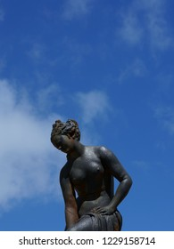 Sculpture of a woman against the sky