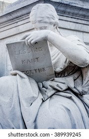 Sculpture of a woman reading philosophy and literature authors of German Enlightenment (Lessing, Kant, and Goethe)
