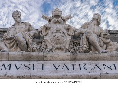 Sculptures above an entrance to the Vatican Museums (Musei Vaticani). Vatican City, Rome, Italy